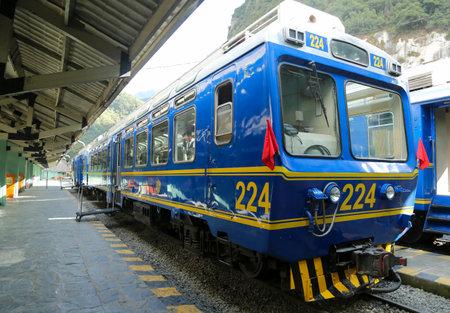 MACHU PICCHU, PERU - OCTOBER 3, 2016: Peru Rail train at Machu Picchu train station in Peru. Machu Picchu is both a cultural and natural UNESCO World Heritage Site from 1983