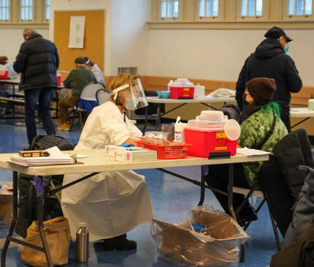 BROOKLYN, NEW YORK - JANUARY 19, 2021: Covid - 19 vaccination site at  Abraham Lincoln Hill School in Brooklyn, New York