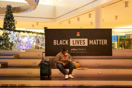 NEW YORK- DECEMBER 30, 2020: Black Lives Matter sign at the JetBlue Terminal 5 at John F Kennedy International Airport in New York Sajtókép