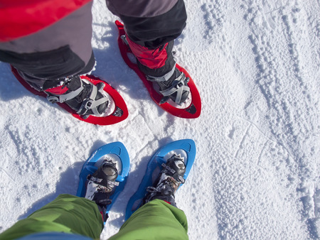 snowshoes: Feet in snowshoes on snow.