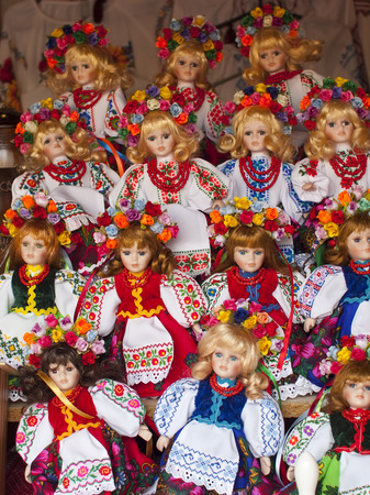 Colorful handmade dolls standing in a row. photo