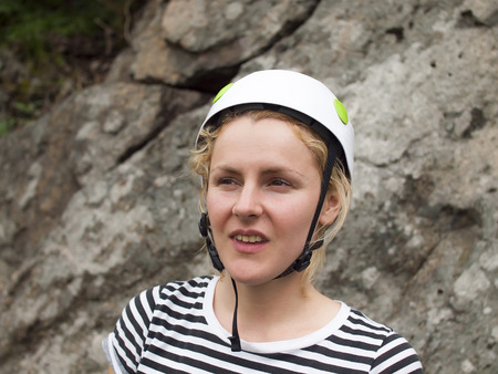 rockclimber: A young climber in the helmet after a difficult climb.