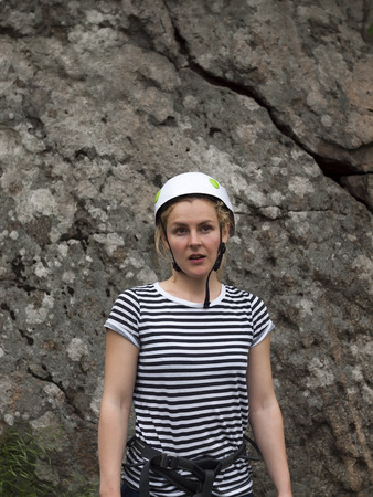 rockclimber: Surprised face of a young girl a climber in helmets for safety. Stock Photo