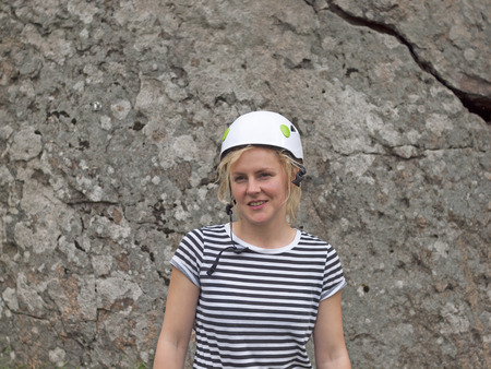 rockclimber: Portrait of a girl rock climbers in the helmet for safety. Stock Photo