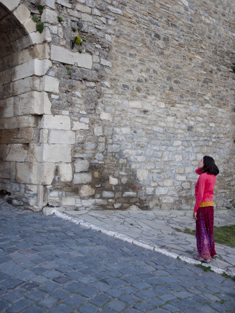 average age: Young and beautiful girl dressed in Oriental style in the castle.