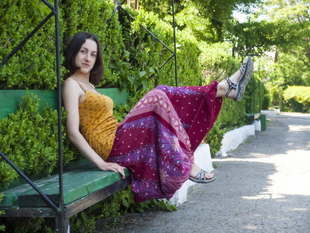 oriental style: Young and beautiful girl dressed in Oriental style fun in the Park. Stock Photo