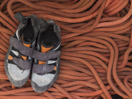 velcro: Shoes for mountaineering and rock climbing is on the orange rope.