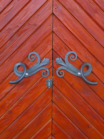 furniture hardware: Old wooden door with metal fittings handmade. Stock Photo