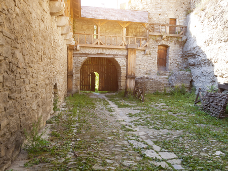 average age: Yard with wooden gate of the old castle in Kamianets-Podilskyi. Kamianets-Podilskyi. Ukraine. August 2, 2015.