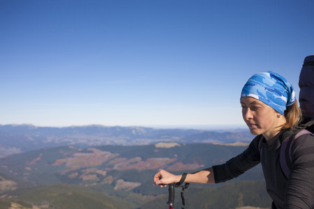 scarring: Portrait of a girl on top of a mountain. Stock Photo