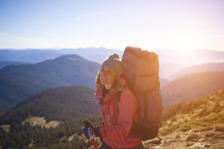 scarring: A girl stands on top of a mountain.