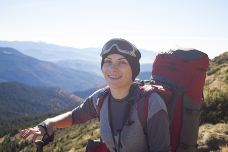 scarring: A woman goes to the top of the mountain.