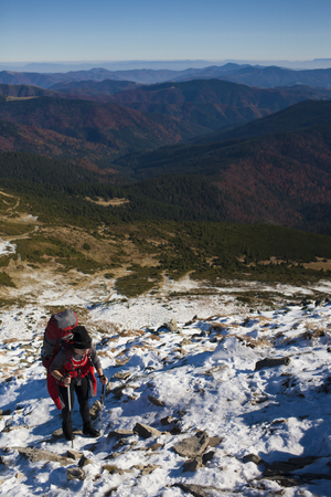 scarring: The girl with the backpack goes to the mountain top.