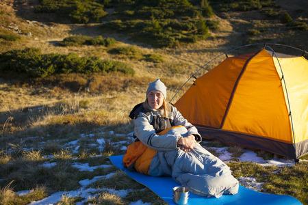 sleeping bag: The girl basking in a sleeping bag at dawn.