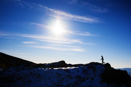 textual: The silhouette of an sportsman which is on the ridge. Stock Photo