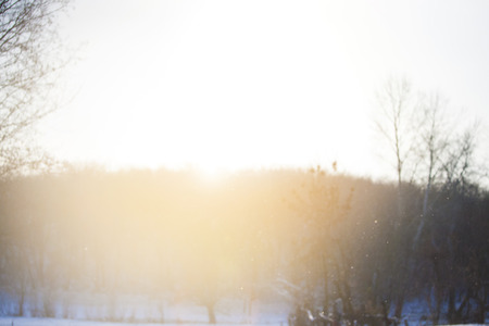 snow clearing: Snow clearing in the rays of the bright sun with blurred focus. Stock Photo