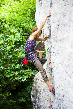 lead rope: The girl spends time actively engaged in climbing.