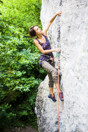 actively: The girl spends time actively engaged in climbing.