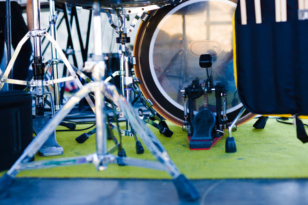 The drum and other musical equipment are on the scene.