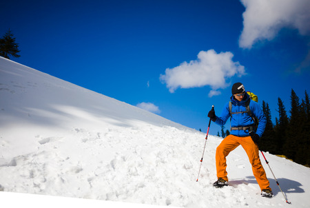 ascent: The climber is happy during the ascent of a snow slope.
