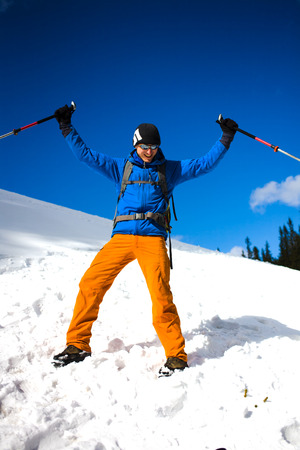 The climber is happy during the ascent of a snow slope.