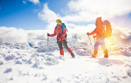 tourists walk in the snow in the mountains during the winter holidays in the mountains, winter in the Ukrainian Carpathians.
