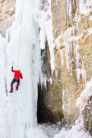 daredevil: A young climber climbs on ice climbing and winter sport activities in cold weather.  Stock Photo