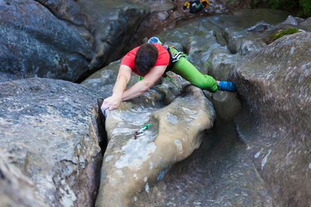 ascends: The athlete climbs the rock, the climber ascends the route. A brave man overcomes his fear.