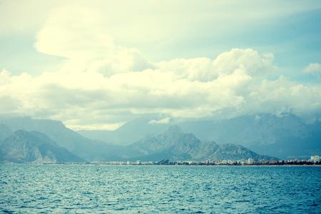 Beautiful sea coast. Coast line of the Mediterranean Sea. Seascape. Turkish resort. Mountains and the ocean.