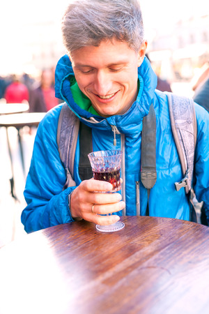 Man holding a glass of red wine. Cherry brandy. Man tasting alcoholic drink. Alcohol addiction. Stockfoto
