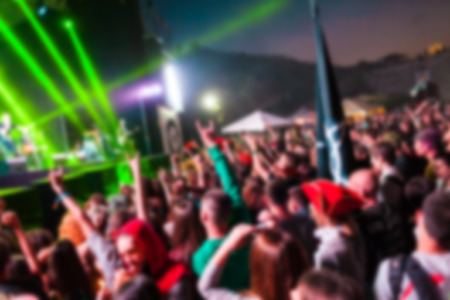 A crowd of people at the music festival. People having fun at the concert. The audience near the stage. The blur effect. Stockfoto
