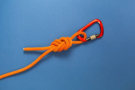 Carabiner and knot from a climbing rope. Equipment for climbing and mountaineering. Knot eight. Stok Fotoğraf