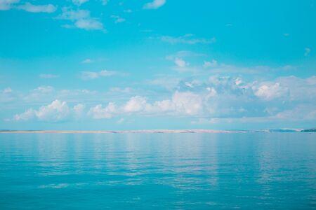 Sea and sky with clouds. Adriatic coast of Croatia. Calm sea surface.