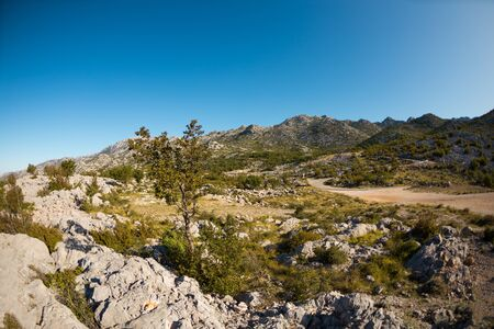 The rocky mountains of Croatia. Mountains against the sky. Journey through the picturesque places of Europe.