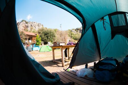 View from the tent. Place for a tent in a climbing camp. Travel and active lifestyle.