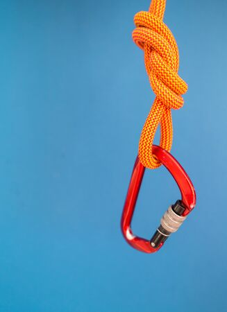 Carabiner and knot from a climbing rope. Equipment for climbing and mountaineering. Knot eight.