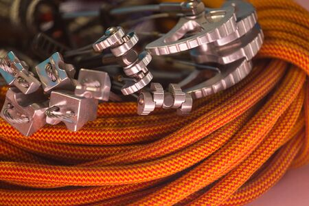 climbing equipment folded on an orange rope. modern equipment for climbing in the mountains. adventure on the rocks.