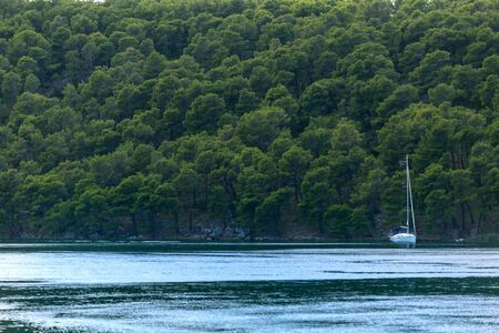 The yacht floating on the river in the national park of Croatia, River transport, Motor boat excursion.