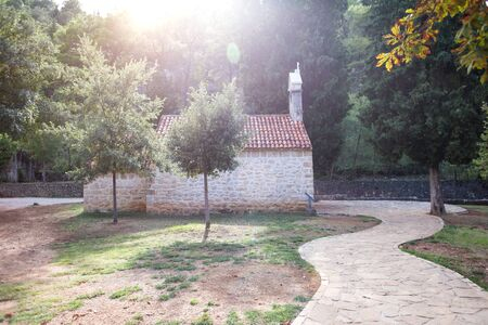 Old stone house in Croatia. The path to the house. The architectural style of the Croatian resort towns.