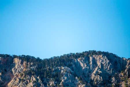 Beautiful Turkish mountains on a background of blue sky, Peak, Climbing in Turkey.