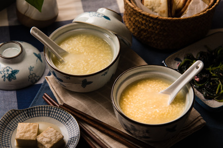 chinese meal: Millet Porridge Served with Fermented Tofu and Steamed Buns - A Traditional Chinese Meal