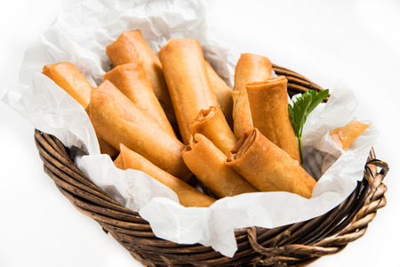 spring holiday: Traditional Asian Fried Spring Rolls with Dipping Sauce on White Background
