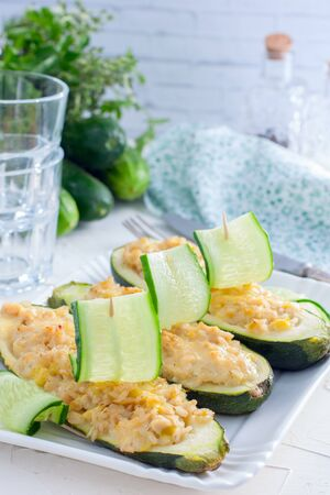 Stuffed halves of courgettes with chicken meat and brown rice, selective focus