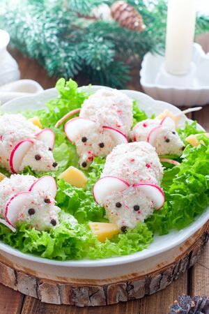 Festive Christmas salad in the form of mice, selective focus