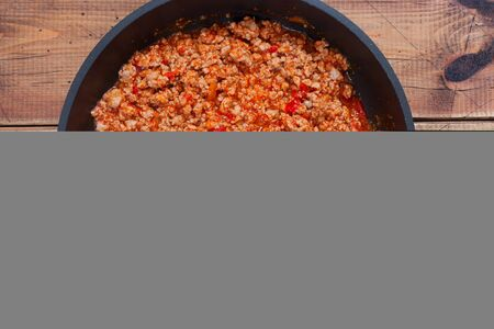 Step-by-step preparation of stuffed cannelloni with bechamel sauce, step 4 - preparation of bolognese sauce, top view, horizontal