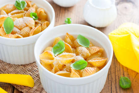 Pasta casserole with egg in white ceramic tins, selective focus Stock Photo