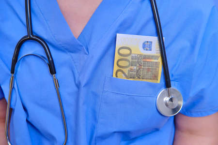 Doctor with a bill in Euro money in the pocket of a medical uniform. A nurse with money to buy medicine for coronavirus, close up