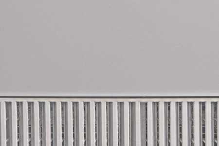 Gray metal surface with a grid at the bottom of two halves, background, copy space