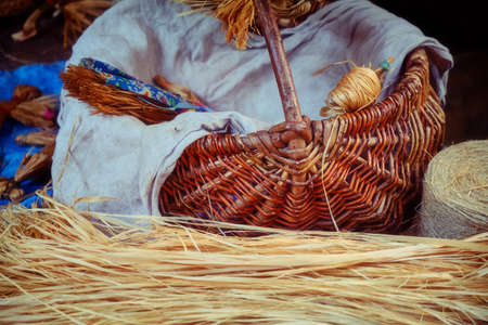 Wicker basket with bast and straw. Workshop for weaving in the village.