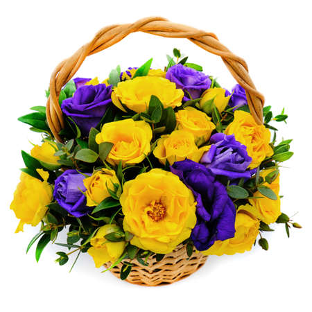 Basket with yellow and blue roses. Beautiful bouquet on white isolated background. Decorative composition of roses. Bright purple and yellow flowers in a wicker basket